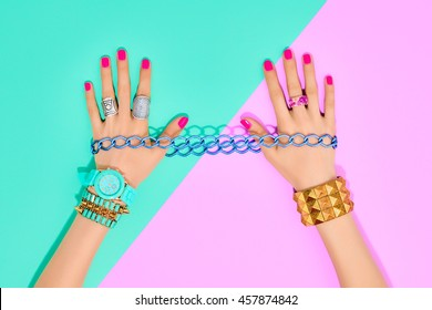 Fashion Accessories Set. Female hands Stylish Trendy Wrist Watches, Glamor bracelets and rings. Summer girl Outfit. Hipster Party Essentials. Art Minimal concept