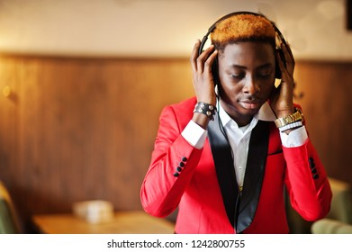 Fashion african american man model DJ at red suit with headphones.