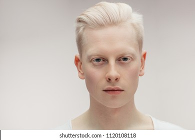 Fashion albino model man portrait isolated on white background. Stylish haircut, perfect skin. Man Beauty and Healthy Skin Care Concept