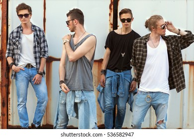fashion american hipster guys sitting near the wooden wall, dressed in jeans and a plaid shirt, sunglasses, Vogue Style