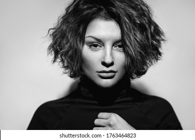 fashion art beauty monochrome portrait.model girl in a black roll neck jumper