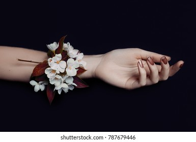 Fashion art hand woman in summer time and flowers on her hand with bright contrasting makeup. Creative beauty photo hand girls sitting at table on contrasting background with colored shadows. Skincare
