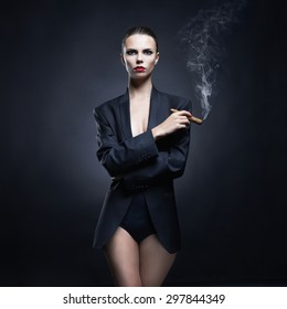 Fashion art photo of beautiful smokes lady with gorgeous body