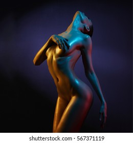 fashion art photo of sexy nude stripper in the night-club. Perfect female body  with oil skin