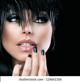 Fashion Art Portrait Of Beautiful Girl. Vogue Style Woman. Hairstyle. Black Hair and Nails. Isolated on Black Background. Beauty Stylish Model Portrait