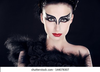 Fashion Art Portrait Of Beautiful Girl. Vogue Style Woman. Closeup portrait of model posing over dark at studio.