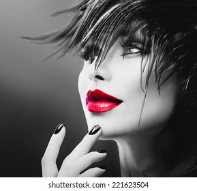 Fashion Art Portrait Of Beautiful Girl. Vogue Style Woman. Hairstyle. Black Hair and Nails, red lipstick. Isolated on Black Background. Beauty Stylish Model Portrait
