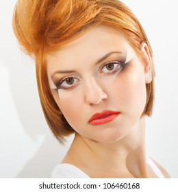 Fashion art portrait of a red hair woman with glamour bright makeup