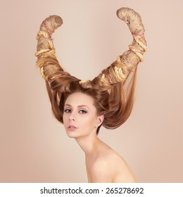 fashion art portrait of sexy beautiful woman with horns. Hairstyle concept girl