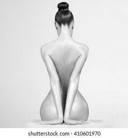 Fashion art studio photo of elegant naked lady