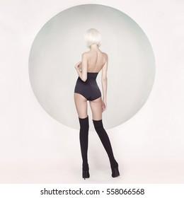 Fashion art studio photo of elegant sensual woman on geometric background