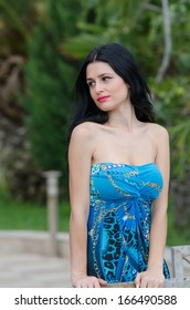 Fashion attractive girl with blue long dress outside