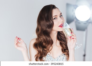 Fashion attractive woman drinking champagne