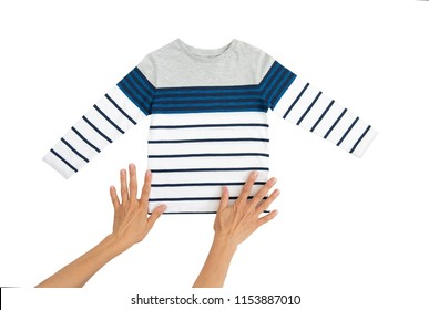 Fashion baby-boy T-shirt with long sleeves and and women's hands isolated on white background for spring and autumn wardrobe/ Baby clothes/ Close-up/ Flat lay
