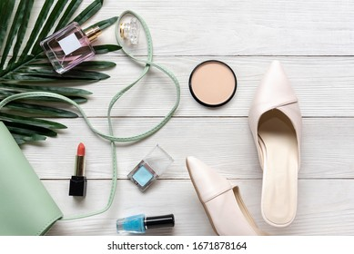 Fashion bag and shoe woman accessories background. Trendy fashion luxury handbag, heels shoe, perfume and cosmetic design. Lifestyle and Beauty Concept