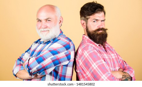 fashion. barbershop and hairdresser salon. youth vs old age compare. retirement. father and son family. generational conflict. two bearded men senior and mature. male beard care. checkered fashion.