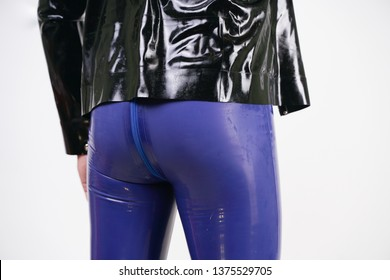 fashion bdsm male have sexy fantasies and wearing fetish latex rubber costume on white background in Studio