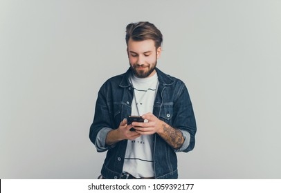 fashion beard man portrait, tattoo hand, Handsome man beard using smartphone in hand, happy face, street photo, hipster style portrait, isolated, make video, instagram. facebook,