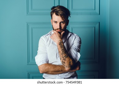 fashion beard man portrait, tattoo hand, Handsome man beard using smartphone in hand, happy face, street photo, hipster style portrait, tattoo