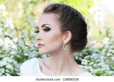Fashion beautiful bride in park