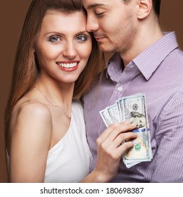 Fashion beautiful couple in love holding money