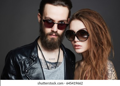 fashion beautiful couple in sunglasses and leather.bearded Hipster boy and beauty girl with tattoo