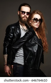 fashion beautiful couple in sunglasses and leather.bearded Hipster boy and beauty girl