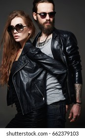 fashion beautiful couple in sunglasses and leather.bearded man and beauty girl