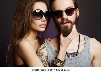 fashion beautiful couple in sunglasses.Hipster boy and girl.bearded man and beauty