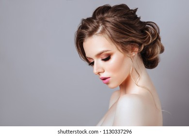 Fashion beautiful model posing at studio close-up face beautiful