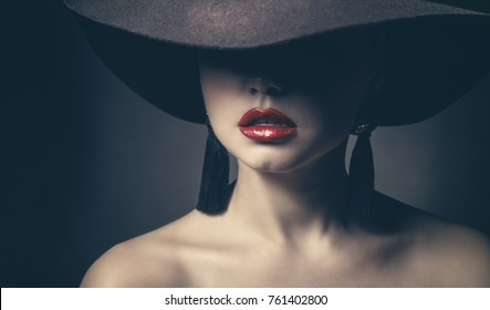 Fashion beautiful woman with red lips, vintage on a dark background