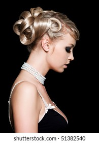 Fashion beautiful woman's hairstyle - portrait in profile