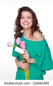 Fashion beautiful young woman with pretty pink tulips on Holiday theme
