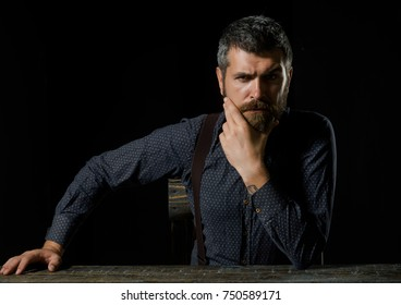 Fashion and beauty. Business and success. Businessman or ceo at table. Man in formal outfit isolated on black background. Manager with beard on serious face., copy space