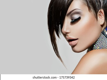 Fashion Beauty Girl. Gorgeous Woman Portrait. Stylish Fringe Haircut and Makeup. Hairstyle. Make up. Vogue Style. Sexy Glamour Girl
