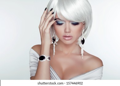 Fashion Beauty Girl. Woman Portrait with White Short Hair. Jewelry. Haircut and Makeup. Hairstyle. Make up. Vogue Style. Sexy Glamour Model