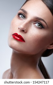 Fashion Beauty Makeup. Beautiful Woman With Red Lips and Luxury Makeup. Beautiful Face