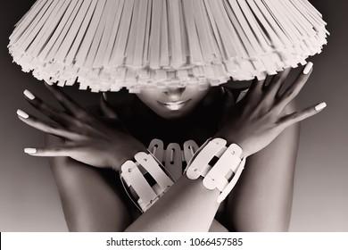 Fashion, beauty. Monochrome portrait of fashionable woman in white hat