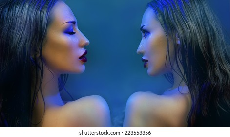 Fashion Beauty. Mystic Make-up. Two mysterious Beautiful Womans With Luxury glossy Makeup. Beautiful sensitive Girl Face. Constellation of the Twins (blue filter)