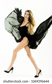 Fashion, beauty and people concept - sexy girl in black petticoat, lingerie and shoe. Swing. Flutter. Sensual woman in black fluttering wind flow transparent dress. Fashion woman in waving black dress