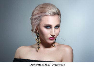 Fashion beauty portrait of a beautiful girl with evening make-up with sequins.