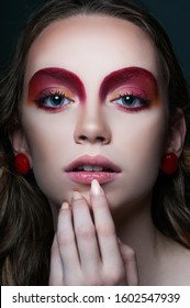 fashion beauty portrait of model with modern vogue trendy make up, magazine editorial ready, close up red eye shadows and lipstick, n studio  - Shutterstock ID 1602547939