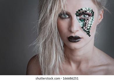 fashion beauty portrait of sexy woman with creative atr make-up