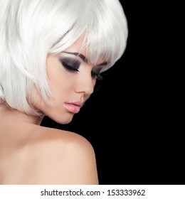 Fashion Beauty Portrait Woman. White Short Hair. Isolated on Black Background. Beautiful Girl Face Close-up. Haircut. Hairstyle. Fringe. Make-up. Vogue Style.