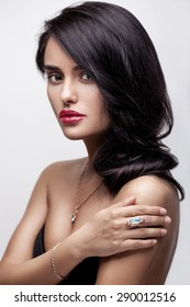 Fashion beauty portrait of a young beautiful attractive brunette girl with long black straight hair, red lips, in underwear.