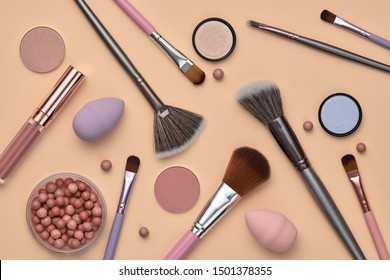 Fashion beauty product fall layout. Woman Essentials cosmetic makeup autumn Set. Collection beauty accessories. Trendy Brushes, lipstick, accessories art Flat lay. Creative make up shopping concept