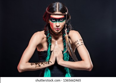 Fashion and beauty shooting a model in the image of an Apache Indian in war paint.