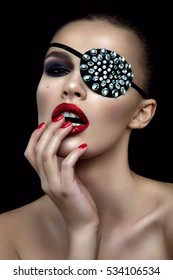 Fashion beauty woman portrait with shiny bandage on eye and red lips.