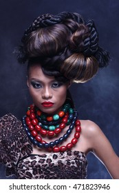 Fashion Black Hair Style in many ball chic on Tan skin asia girl with color accessory, dark background in studio lighting