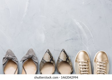 Fashion, blog, blogging, lifestyle, well-being trendy concept. Set of female shoes, sneakers on gray background, top view, copy space, flat lay
